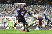 Lionel Messi of Barcelona and Daniel Carvajal of Real Madrid clash  during the La Liga match between Real Madrid CF and FC Barcelona at Estadio Santiago Bernabeu on March 02, 2019 in Madrid, Spain.
