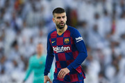 Gerard Pique of FC Barcelona runs with the ball during the Liga match between Real Madrid CF and FC Barcelona at Estadio Santiago Bernabeu on March 01, 2020 in Madrid, Spain.