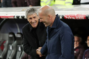 Quique Setien, Head Coach of Barcelona shakes hands with Zinedine Zidane, Manager of Real Madrid prior to the Liga match between Real Madrid CF and FC Barcelona at Estadio Santiago Bernabeu on March 01, 2020 in Madrid, Spain.