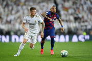 Toni Kroos of Real Madrid battles for possession with Arturo Vidal of FC Barcelona during the Liga match between Real Madrid CF and FC Barcelona at Estadio Santiago Bernabeu on March 01, 2020 in Madrid, Spain.
