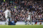 Karim Benzema (2ndL) of Real Madrid CF scores their third goal during the La Liga match between Real Madrid CF and Granada CF at Estadio Santiago Bernabeu on January 7, 2017 in Madrid, Spain.