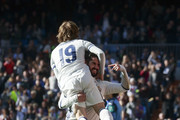 Francisco Roman Alarcon alias Isco (R) of Real Madrid CF celebrates scoring their fourth goal with teammate Luka Modric (L) during the La Liga match between Real Madrid CF and Granada CF at Estadio Santiago Bernabeu on January 7, 2017 in Madrid, Spain.