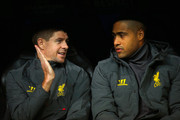 (L-R) Steven Gerrard. Glen Johnson of Liverpool talk as they sit on substitute the bench during the UEFA Champions League Group B match between Real Madrid CF and Liverpool FC at Estadio Santiago Bernabeu on November 4, 2014 in Madrid, Spain.
