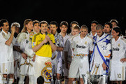 Real Madrid CF captain Iker Casillas (3rd L) addresses their fans beside his team-mates Alvaro Arbeloa (L), Sergio Ramos (2nd L) Karim Benzema (C) Pepe (2nd R) and Mesut Ozil after the La Liga match between Real Madrid CF and RCD Mallorca at Estadio Santiago Bernabeu on May 13, 2012 in Madrid, Spain.