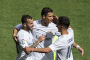 Jese Rodriguez (L) of Real Madrid CF celebrates scoring their fourth goal with teammates Cristiano Ronaldo (2ndL) and Lucas Vazquez (R) during the La Liga match between Real Madrid CF and SD Eibar at Estadio Santiago Bernabeu on April 9, 2016 in Madrid, Spain.