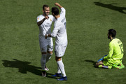 Jese Rodriguez (L) of Real Madrid CF celebrates scoring their fourth goal with teammate Cristiano Ronaldo (2ndL) during the La Liga match between Real Madrid CF and SD Eibar at Estadio Santiago Bernabeu on April 9, 2016 in Madrid, Spain.