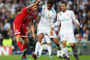 Thomas Mueller of Bayern Muenchen shoots during the UEFA Champions League Semi Final Second Leg match between Real Madrid and Bayern Muenchen at the Bernabeu on May 1, 2018 in Madrid, Spain.