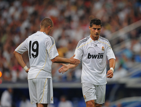 Cristiano Ronaldo (R) of Real Madrid shakes hands with Karim Benzema during the Peace Cup match between Real Madrid and Al-Ittihad at the Santiago Bernabeu stadium on July 26, 2009 in Madrid, Spain.