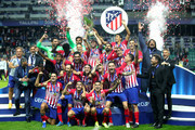 Diego Godin of Atletico Madrid lifts the trophy as Atletico Madrid celebrate victory in the UEFA Super Cup between Real Madrid and Atletico Madrid at Lillekula Stadium on August 15, 2018 in Tallinn, Estonia.