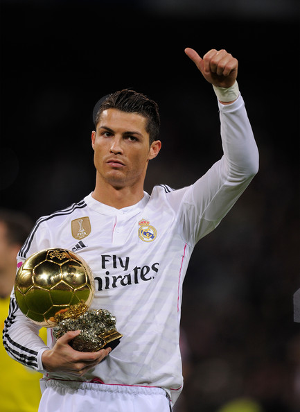 Cristiano Ronaldo of Real Madrid salutes with his FIFA Ballon d'Or before the Copa del Rey Round of 16, Second leg match between Real Madrid and Atletico de Madrid at Estadio Santiago Bernabeu on January 15, 2015 in Madrid, Spain.