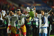 Pepe , Sergio Ramos and Ángel Di Maria of Real Madrid celebrate with the Champions League trophy during the UEFA Champions League Final between Real Madrid and Atletico de Madrid at Estadio da Luz on May 24, 2014 in Lisbon, Portugal.