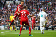 Joshua Kimmich of Bayern Muenchen (L) celebrates after scoring his sides first goal with Thomas Mueller of Bayern Muenchen during the UEFA Champions League Semi Final Second Leg match between Real Madrid and Bayern Muenchen at the Bernabeu on May 1, 2018 in Madrid, Spain.