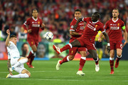 Toni Kroos of Real Madrid attempts to block Sadio Mane of Liverpool during the UEFA Champions League Final between Real Madrid and Liverpool at NSC Olimpiyskiy Stadium on May 26, 2018 in Kiev, Ukraine.