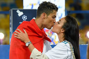 Cristiano Ronaldo of Real Madrid CF kisses hsi girlfriend Georgina Rodriguez as they celebrate his side victory following winning the UEFA Champions League final between Real Madrid and Liverpool on May 26, 2018 in Kiev, Ukraine.