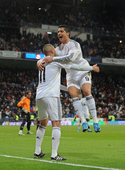 Cristiano Ronaldo (R) of Real Madrid congratulates  Karim Benzema after he scored Madrid's sixth goal during the La Liga match between Real Madrid and Real Zaragoza at the Santiago Bernabeu stadium on December 19, 2009 in Madrid, Spain.