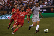 Javier Pastore #27 of Roma fights for the ball with Daniel Carvajal #2 of Real Madrid during their match at MetLife Stadium on August 7, 2018 in East Rutherford, New Jersey.