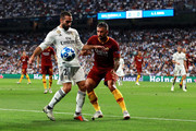 Daniel Carvajal of Real Madrid battles for possession with Aleksandar Kolarov of AS Roma during the Group G match of the UEFA Champions League between Real Madrid  and AS Roma at Bernabeu on September 19, 2018 in Madrid, Spain.