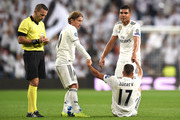 Luka Modric of Real Madrid and Casemiro of Real Madrid help Lucas Vazquez of Real Madrid to his feet during the Group G match of the UEFA Champions League between Real Madrid  and Viktoria Plzen at Bernabeu on October 23, 2018 in Madrid, Spain.
