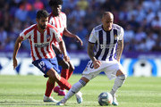 Diego Costa of Atletico de Madrid kicks the ball against Sandro of Real Valladolid during the Liga match between Real Valladolid CF and Club Atletico de Madrid at Jose Zorrilla on October 06, 2019 in Valladolid, Spain.