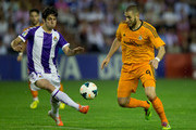 Karim Benzema (R) of Real Madrid CF competes for the ball with Marc Valiente (L) of Real Valladolid CF during the La Liga match between Real Valladolid CF and Real Madrid CF at Estadio Jose Zorilla on May 7, 2014 in Valladolid, Spain.