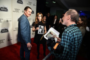 """Ethan Hawke and Lisa Loeb look at photos taken by photographer Gary Gershoff in 1994 from Lisa Loeb's """"Stay"""" video that was directed by Ethan Hawke at the """"Reality Bites"""" 25th Anniversary - 2019 Tribeca Film Festival at BMCC Tribeca PAC on May 04, 2019 in New York City."""
