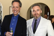 (L-R) Richard E. Grant and Michael Howells British Consul General in Los Angeles attend the Reception For UK Oscars Nominees at British Consul General's Residence on February 22, 2019 in Los Angeles, California.