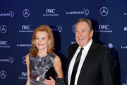 Gerard Houllier and guest attend the 2016 Laureus World Sports Awards at Messe Berlin on April 18, 2016 in Berlin, Germany.