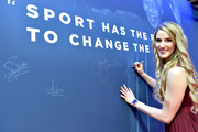 Laureus Academy Member Missy Franklin signs the Nelson Mandela wall during the 2019 Laureus World Sports Awards on February 18, 2019 in Monaco, Monaco.