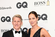 Bastian Schweinsteiger and Ana Ivanovic arrive for the 20th GQ Men of the Year Award at Komische Oper on November 8, 2018 in Berlin, Germany.