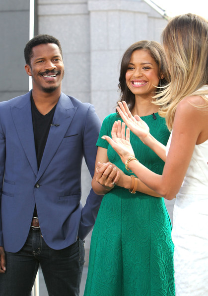 Gugu Mbatha-Raw and Nate Parker on the 'Extra' Set