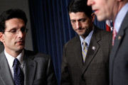 U.S. House Minority Whip Rep. Eric Cantor (R-VA) (L) and Rep. Paul Ryan (R-WI) (R) pause during a news conference on the health care legislation March 19, 2010 on Capitol Hill in Washington, DC. The House will vote on the Health Care Reform Legislation on Sunday.