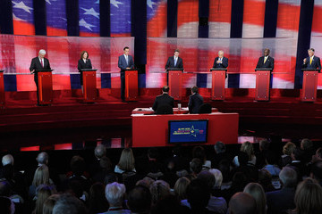Ron Paul Michele Bachmann Republican Candidates Participate In Debate At Reagan Library