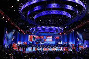 CNN's Anderson Cooper (L) moderates the Republican presidential debate with candidates (L-R) U.S. Sen. Rick Santorum (R-PA), U.S. Rep. Ron Paul (R-TX), former CEO of Godfather's Pizza Herman Cain, former Massachusetts Gov. Mitt Romney, Texas Gov. Rick Perry, Former Speaker of the House Newt Gingrich and U.S. Rep. Michele Bachmann (R-MN) on stage duirng the debate airing on CNN, October 18, 2011 in Las Vegas, Nevada. Seven GOP contenders are taking part in the debate, which is sponsored by the Western Republican Leadership Conference in Las Vegas and held in the Venetian Hotel's Sands Expo and Convention Center.