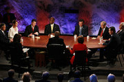 Texas Gov. Rick Perry (3rd L) speaks as (L-R) Jon Huntsman, U.S. Rep. Michele Bachmann (R-MN), Herman Cain, Mitt Romney, U.S. Rep. Ron Paul (R-TX), Rick Santorum and Newt Gingrich look on during the Republican Presidential debate hosted by Bloomberg and the Washington Post on October 11, 2011 at Dartmouth College in Hanover, New Hampshire. Eight GOP candidates met for the first debate of the 2012 campaign focusing solely on the economy.