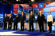 (L-R) U.S. Sen. Rick Santorum (R-PA), U.S. Rep. Ron Paul (R-TX), former CEO of Godfather's Pizza Herman Cain, former Massachusetts Gov. Mitt Romney, Texas Gov. Rick Perry, Former Speaker of the House Newt Gingrich and U.S. Rep. Michele Bachmann (R-MN) participate in a Republican presidential debate on October 18, 2011 in Las Vegas, Nevada. Seven GOP contenders are taking part in the debate, which is sponsored by the Western Republican Leadership Conference in Las Vegas and held in the Venetian Hotel's Sands Expo and Convention Center.