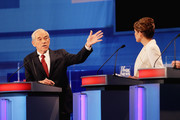 Republican presidential candidates U.S. Rep. Ron Paul (R-TX) (L), gets into a heated exchange with  U.S. Rep. Michele Bachmann (R-MN), during the Fox News Channel debate at the Sioux City Convention Center on December 15, 2011 in Sioux City, Iowa. The GOP contenders are in the final stretch of campaigning in Iowa where the January 3rd caucus is the first test the candidates must face before becoming the Republican presidential nominee.