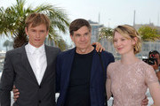 """(L-R) Actor Henry Hopper, director Gus van Sant and actress Mia Wasikowska attends the """"Restless"""" Photocall during the 64th Cannes Film Festival at the Palais des Festivals on May 13, 2011 in Cannes, France."""