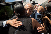 Rev. Al Sharpton hugs Ellisha Garner following a press conference after meeting with Department of Justice officials, June 21, 2017 in the Brooklyn borough of New York City. The family was expected to receive a status report on the progress of the civil rights investigation into Eric Garner's police-involved choking death.