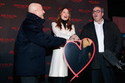 (L-R) Chairman and CEO of MacAndrews & Forbes Holdings Inc. Ron Perelman, actress Olivia Wilde and CEO of Revlon Lorenzo Delpani attend Revlon LOVE IS ON With Olivia Wilde in Times Square on November 18, 2014 in New York City.