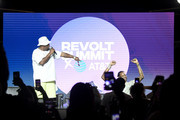 """Sean """"Diddy"""" Combs and 2 Chainz speak onstage during day 2 of REVOLT Summit x AT&T Summit on September 13, 2019 in Atlanta, Georgia."""