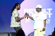 """2 Chainz and Sean """"Diddy"""" Combs speaks onstage during day 2 of REVOLT Summit x AT&T Summit on September 13, 2019 in Atlanta, Georgia."""