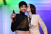 Honoree Nik Dodani (L) and Brigette Lundy-Paine seen onstage at the closing night gala and Visibility Awards during Revry's 4th Annual QueerX Festival at The London West Hollywood on June 02, 2019 in West Hollywood, California.