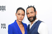 Rebecca Mir and Massimo Sinato attend the Riani show during the Berlin Fashion Week Spring/Summer 2019 at ewerk on July 4, 2018 in Berlin, Germany.
