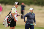 Premier League referee Mike Dean looks on while caddying for Lydia Hall of Wales during day three of Ricoh Women's British Open at Royal Lytham & St. Annes on August 4, 2018 in Lytham St Annes, England.