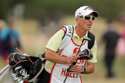Premier League referee Mike Dean caddying for Lydia Hall of Wales during day three of Ricoh Women's British Open at Royal Lytham & St. Annes on August 4, 2018 in Lytham St Annes, England.