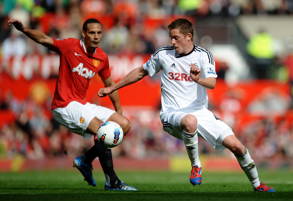 Rio Ferdinand and Gylfi Sigurdsson - Manchester United v Swansea City - Premier League