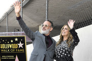 Tom Hanks stands with her wife as Rita Wilson is honored with a star on the Hollywood Walk of Fame on March 29, 2019 in Hollywood, California.