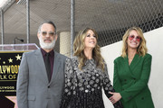 Tom Hanks, wife Rita Wilson, and Julia Roberts stand on Wilson's newly unveiled star after she was honored on the Hollywood Walk of Fame in Hollywood,, California on March 29, 2019.