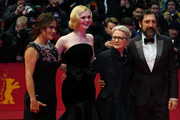 """(R-L) Javier Bardem, director Sally Potter, Elle Fanning and Salma Hayek pose at the """"The Roads Not Taken"""" premiere during the 70th Berlinale International Film Festival Berlin at Berlinale Palace on February 26, 2020 in Berlin, Germany."""