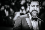 """Image was converted to black and white) Javier Bardem arrives for the """"The Roads Not Taken"""" premiere during the 70th Berlinale International Film Festival Berlin at Berlinale Palace on February 26, 2020 in Berlin, Germany."""